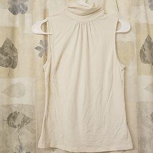 Beautiful cream turtleneck sleeveless top, stylish